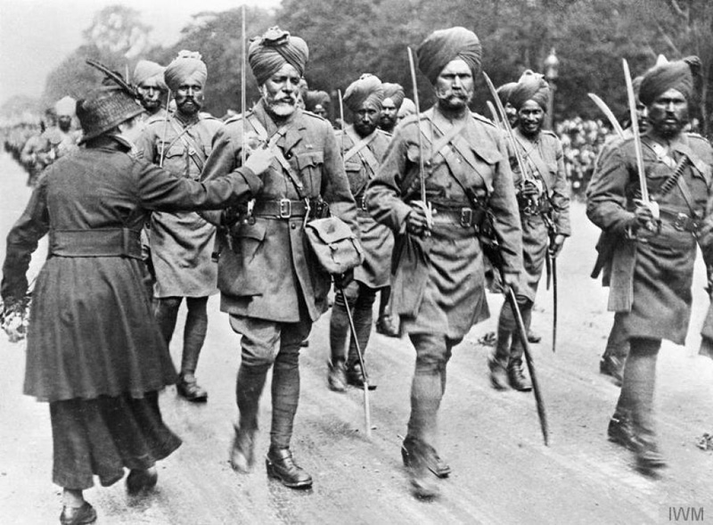 During-a-march-past-of-Indian-troops-a-woman-pins-flowers-on-a-soldiers-tunic_copyright_IWM