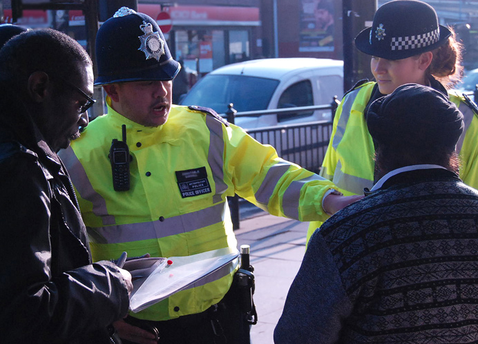 Police and council officers chatting to trader in Southall during the operation