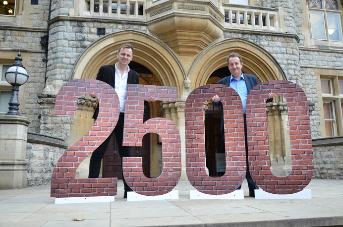 Councillors Peter Mason and Julian Bell with 2,500 number - the target for new affordable homes