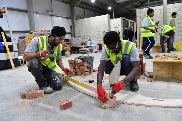 Students on construction academy course learning bricklaying skills