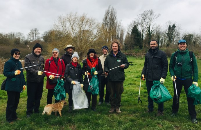 Great British Spring Clean volunteers with council park ranger