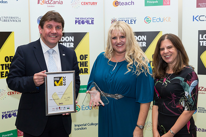 Headteacher of the year Kerry Shilling (centre) with Stephen Metcalfe MP and Rosalind Azouzi of ceremony hosts the Royal Aeronautical-Society
