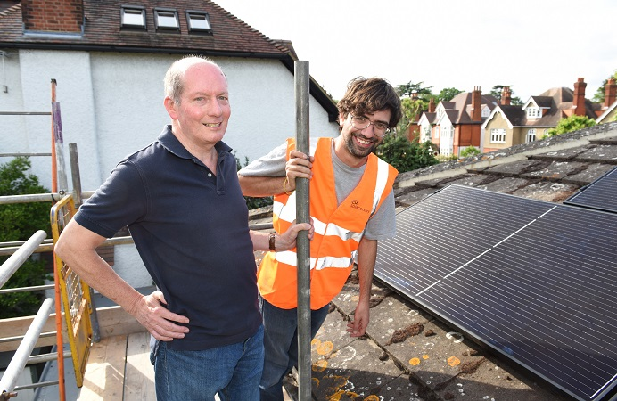 All smiles while installing clean energy options