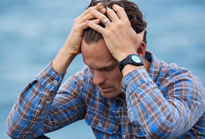 Man sitting looking stressed, worried