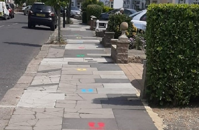 Colourful markings on the pavement to encourage children to walk to school