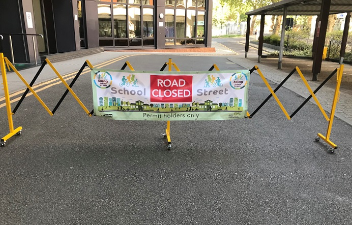 road barrier with banner school streets