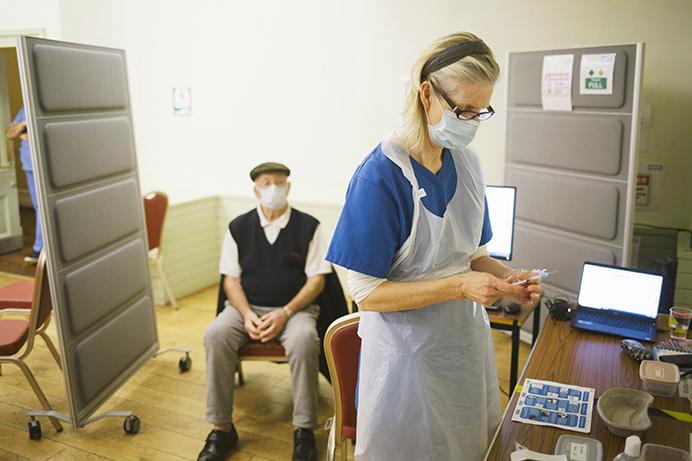 Nurse administering vaccines in Ealing