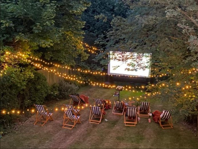 Outdoor cinema screen and chairs
