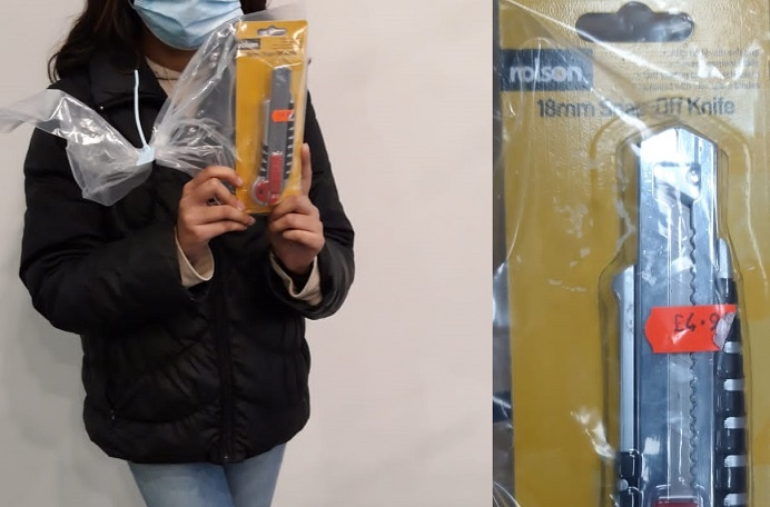 Anonymous girl with knife and knife in packaging