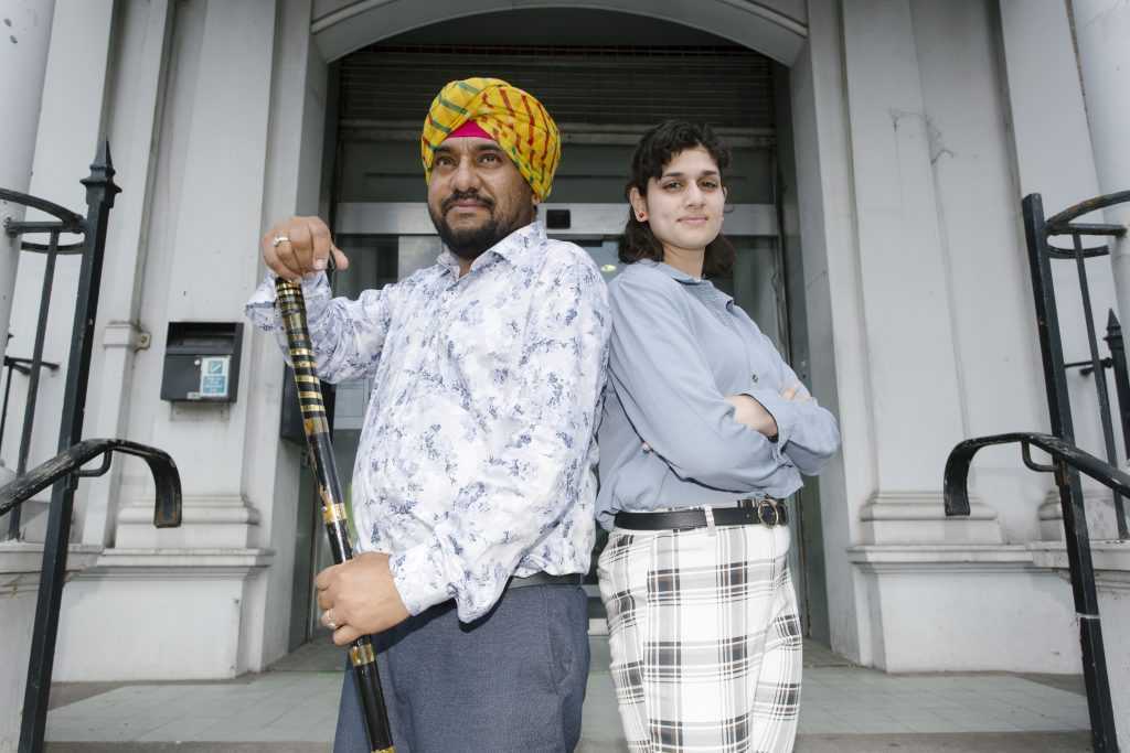 Man and woman standing on the steps of Southall Town Hall