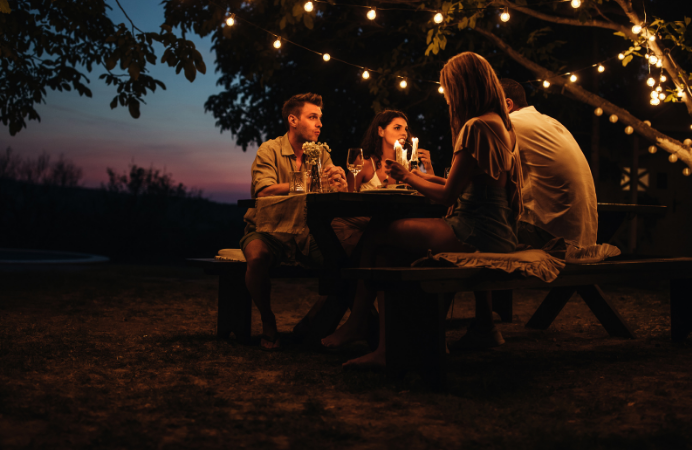 A group of people dining outdoors