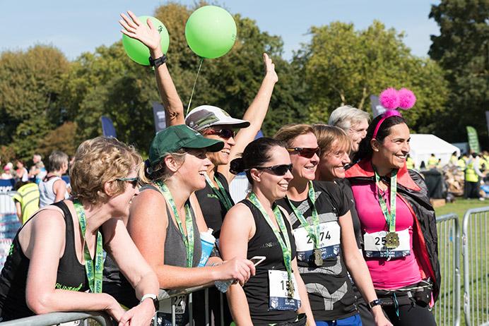 Group of women runners celebrating after finishing the Ealing Half Marathon