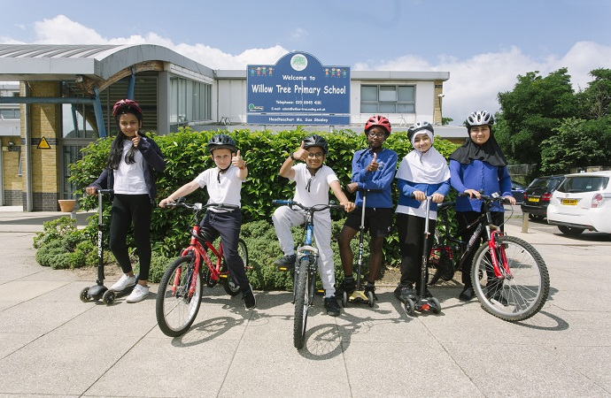 Pupils at Willow Tree Primary School on bikes and scooters