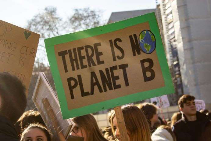 Placard saying 'There is no planet B' being held aloft at a protest