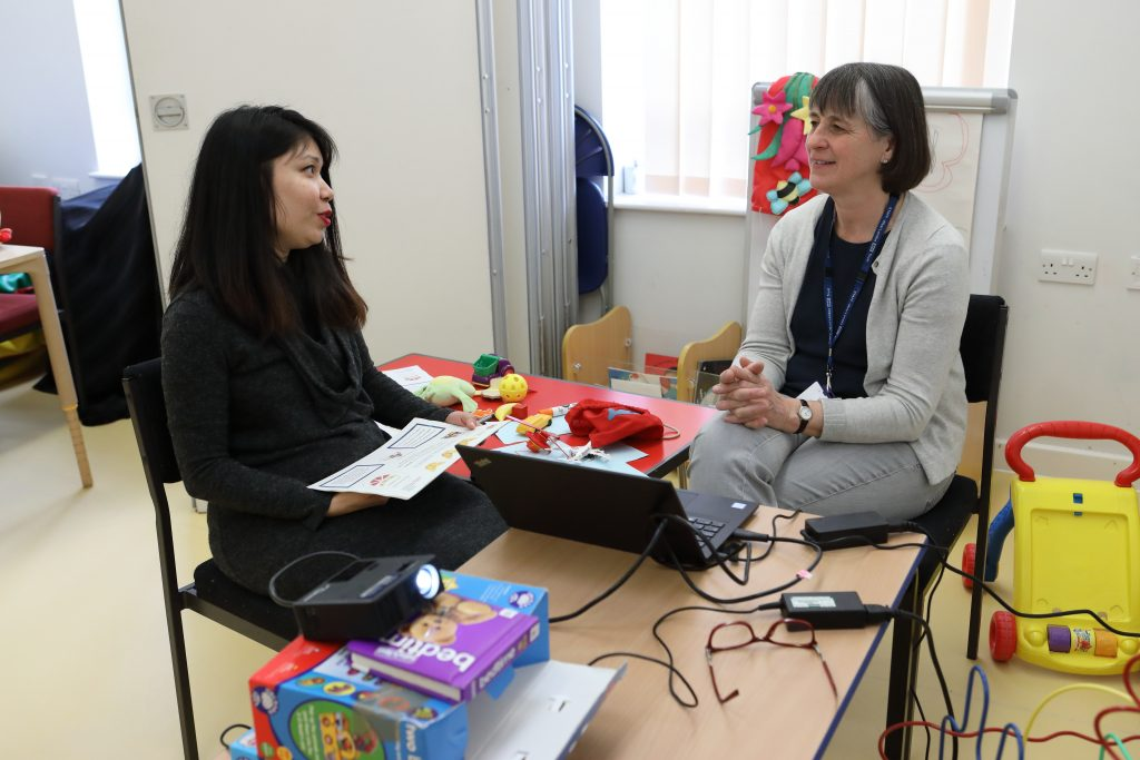 Two women chatting in an office