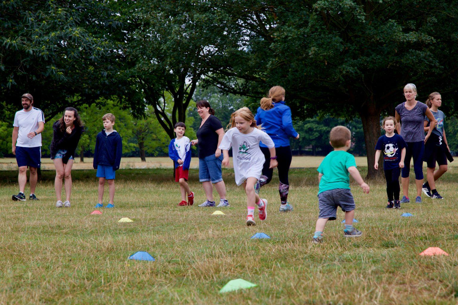 Children running on grass in a park