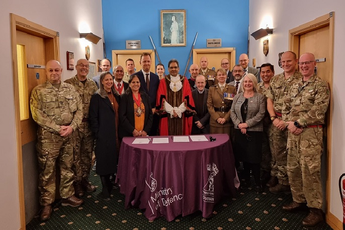 Group picture of military personnel and Ealing Council